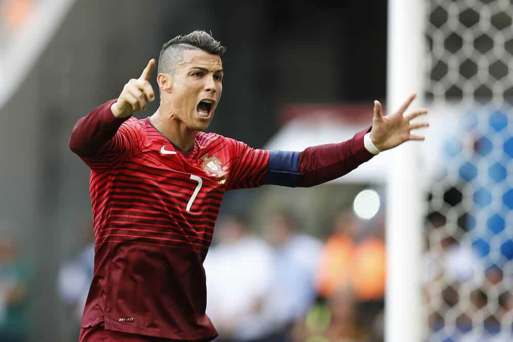 Cristiano Ronaldo of Portugal celebrates after scoring a goal during the game between Portugal and Ghana at Estadio Mane Garrincha