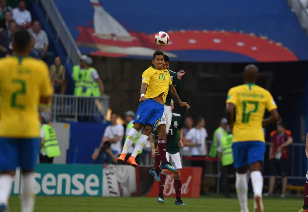 Brazil Striker Roberto Firmino plays the ball off with his head jump during the match of 18 final of world football championship in 2018