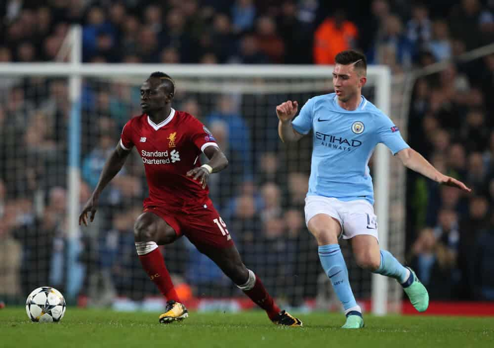 Sadio Mane and Aymeric Laporte during the Champions League quarter final match between Manchester City and Liverpool at the Etihad Stadium on April 10, 2018
